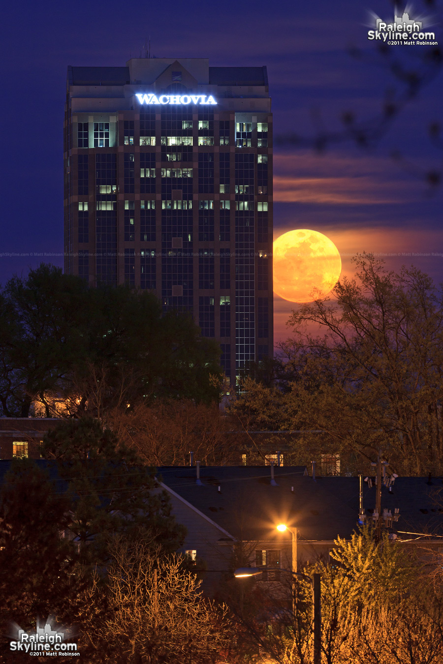 The Supermoon rises behind Wachovia Capitol Center in Raleigh, NC on March 19, 2011
