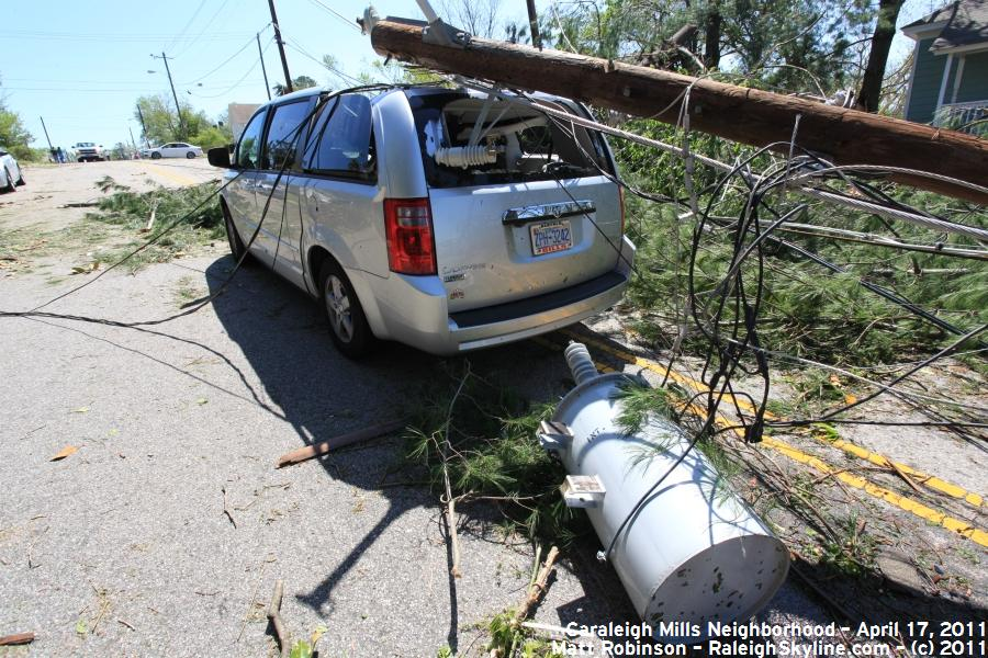Transformer and utility poll down on a van along Maywood Avenue