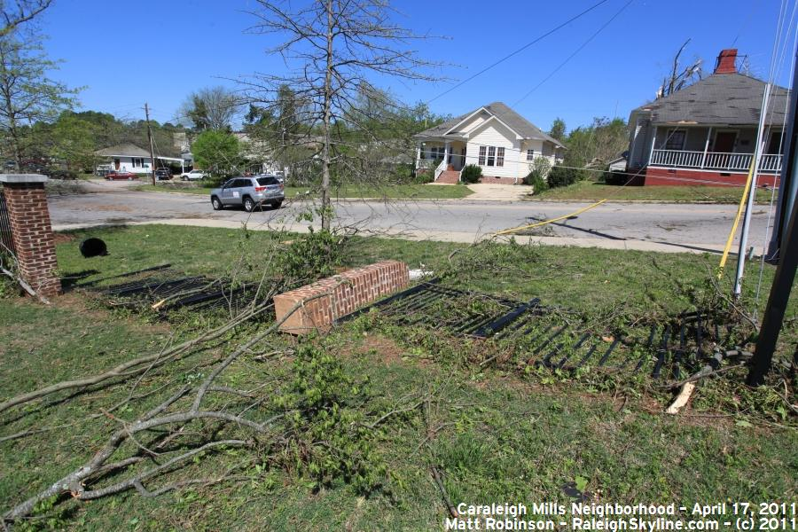 Metal and brick fence damaged by Tornado