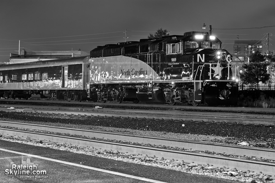 NCDOT City of Durham locomotive sits at City of Raleigh Amtrak Station