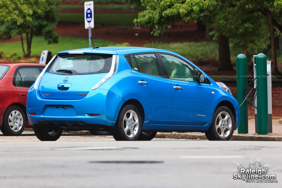 A Nissan Leaf charges its batteries at Nash Square (also spotted a Tesla Roadster charging here)