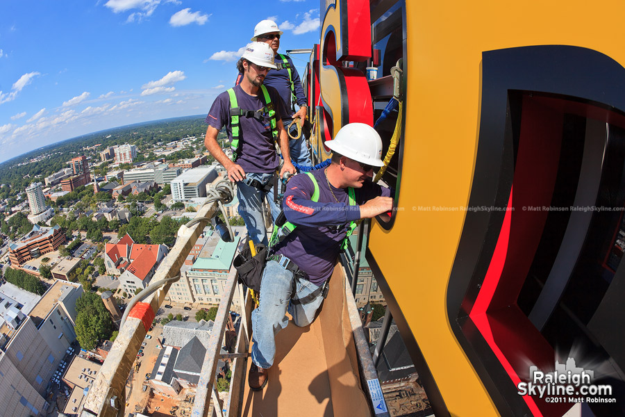 Workers from Atlas Signs complete wiring for illumination of the Wells Fargo signage