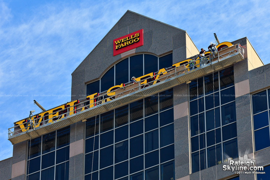 Ground level view of the stage scaffolding for the Wells Fargo sign