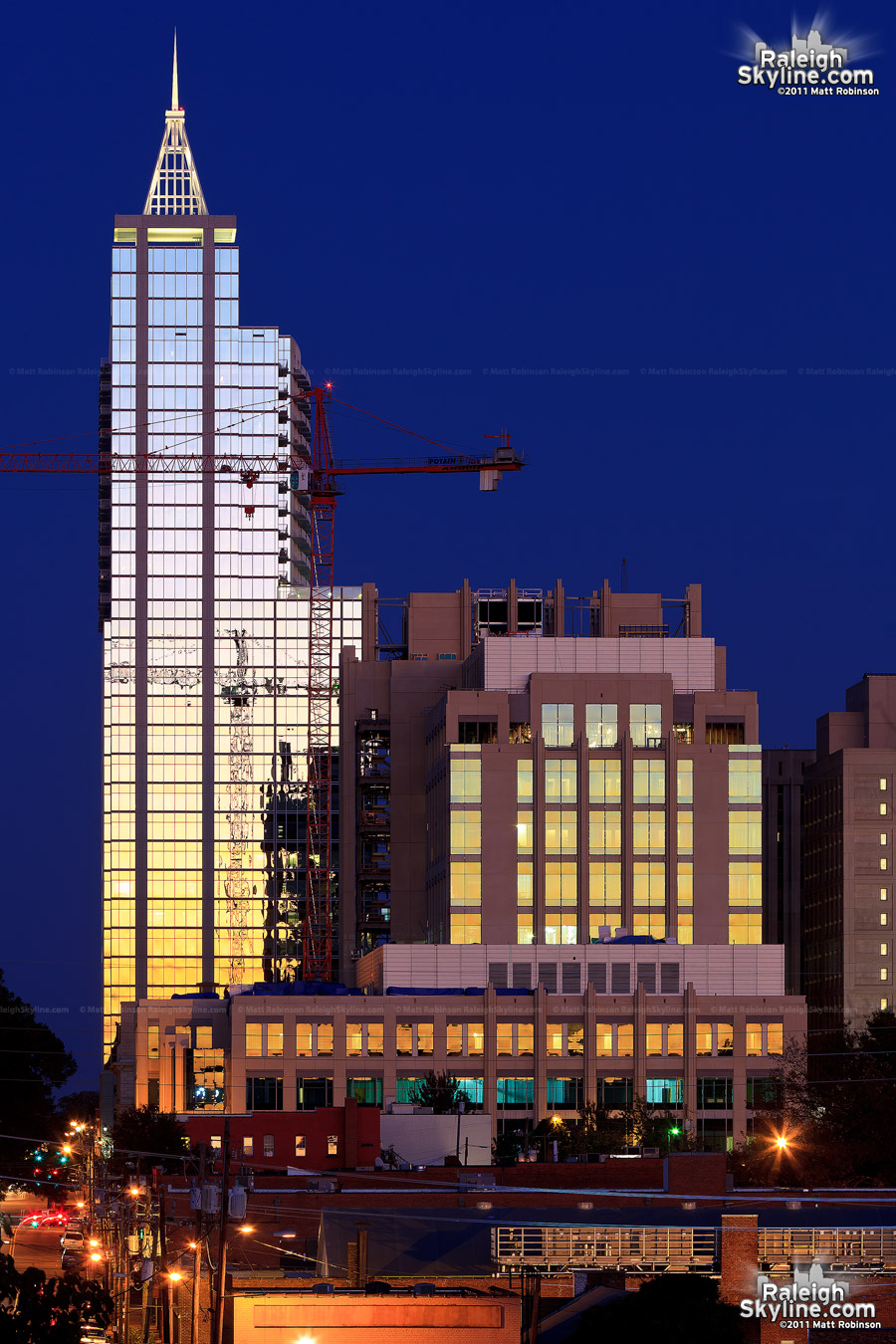RBC Plaza and the Wake County Justice Center reflect the western sky after sunset