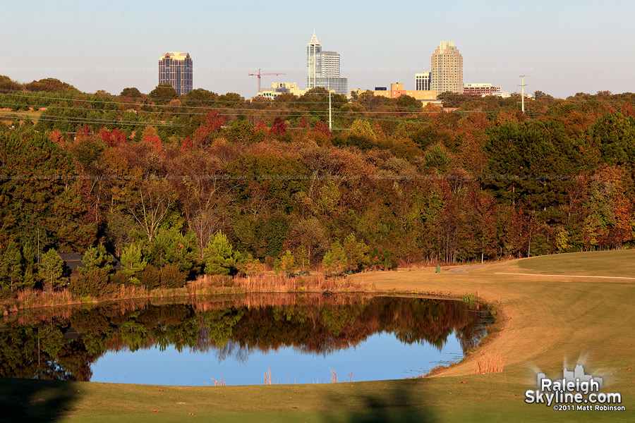 Raleigh peeks over the autumn colors from Lonnie Poole Golf Course