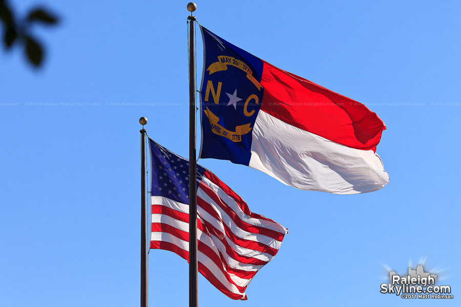State flag of North Carolina with American flag
