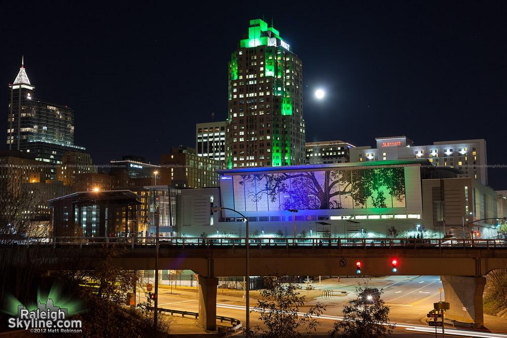Full moon and Jupiter over the Raleigh skyline