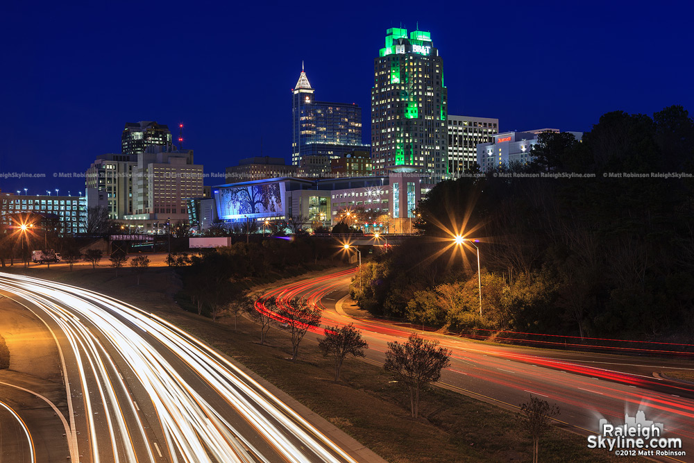City traffic with downtown Raleigh from Western Boulevard Overpass