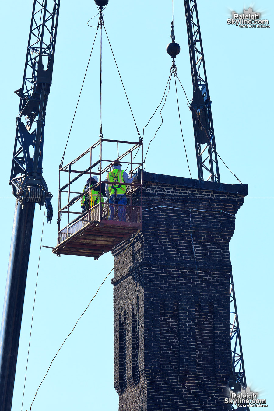 Fixing the tornado damaged Caraleigh Mills smokestack cap