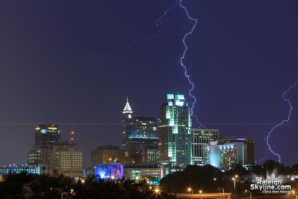 Lightning strikes behind downtown