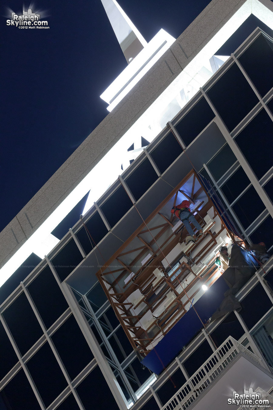 Installation work for the PNC Sign on the north face of RBC Plaza