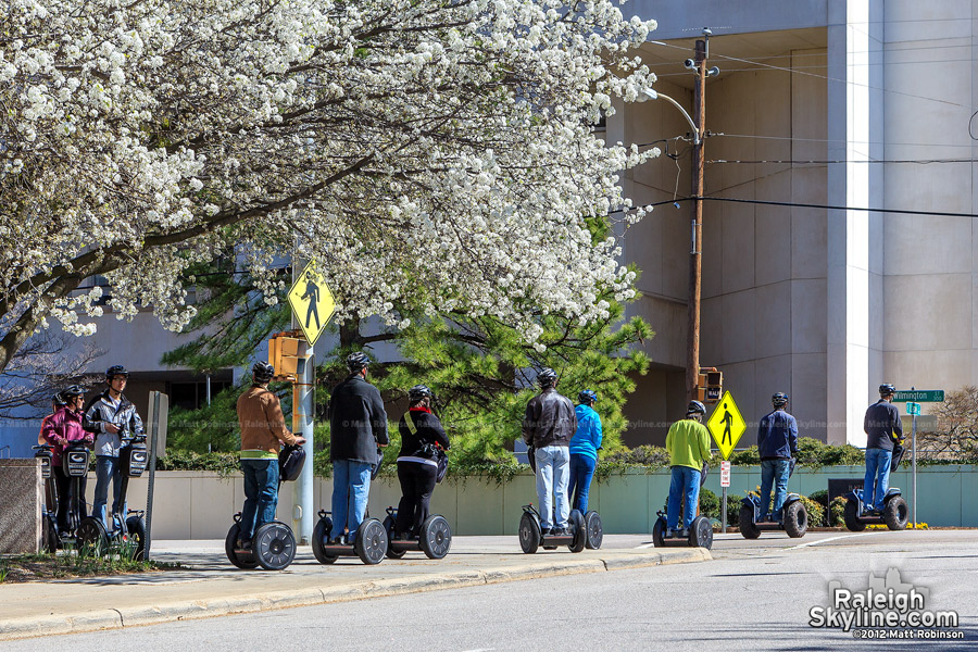 Segway tour attendees cross North Wilmington Street in Raleigh
