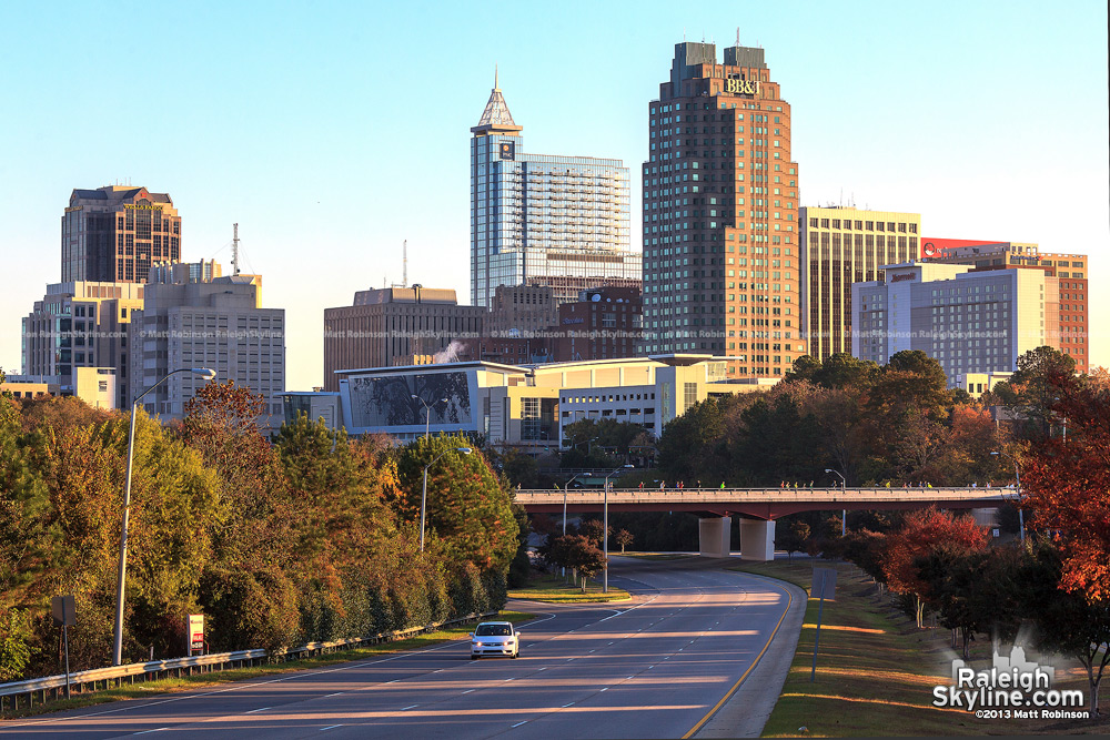 Fall morning skyline with Raleigh marathon runners