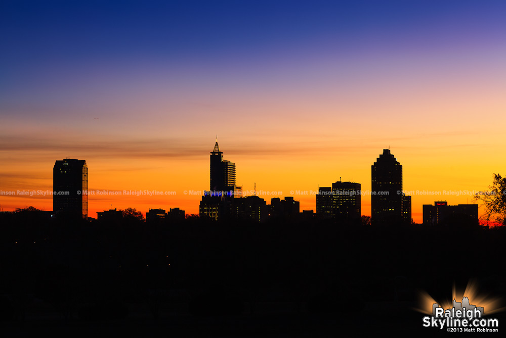 A frigid sunrise silhouette of Raleigh