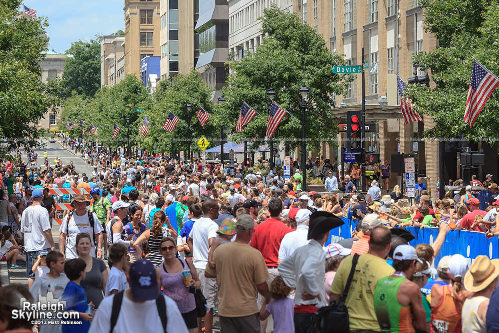 Crowds cheer on participants of the Ironman on Fayetteville Street