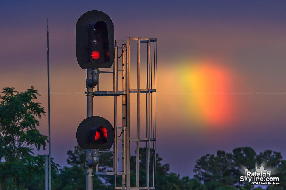 Rainbow behind railroad signal