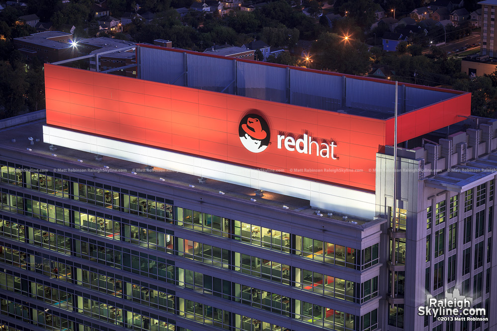 Red Hat Tower sign at night from PNC Plaza rooftop