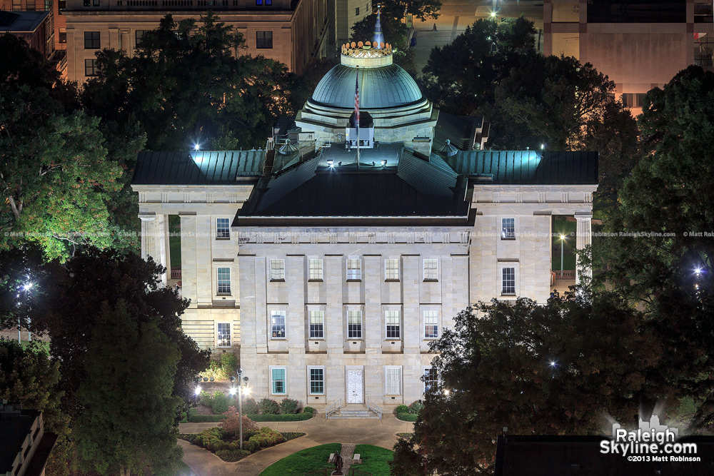 Nighttime view of the North Carolina State capital at night from PNC Plaza