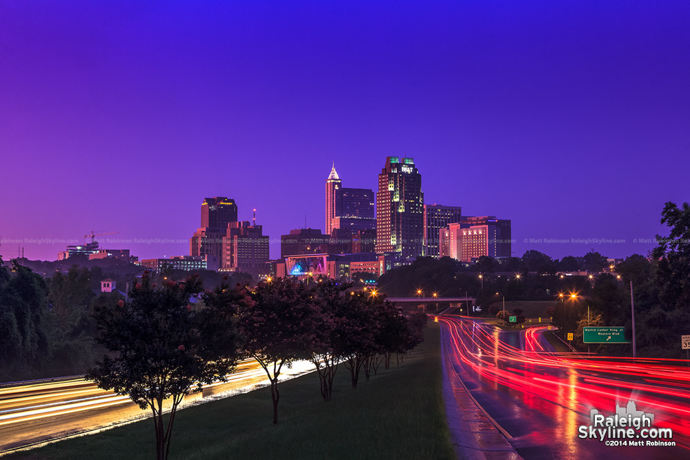 Purple hues and pink reflections bath downtown Raleigh at sunset after a storm - July 27, 2012
