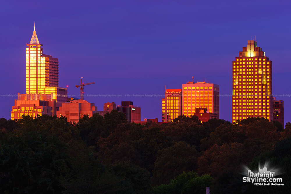 Sunset reflections shine on the Raleigh Skyline
