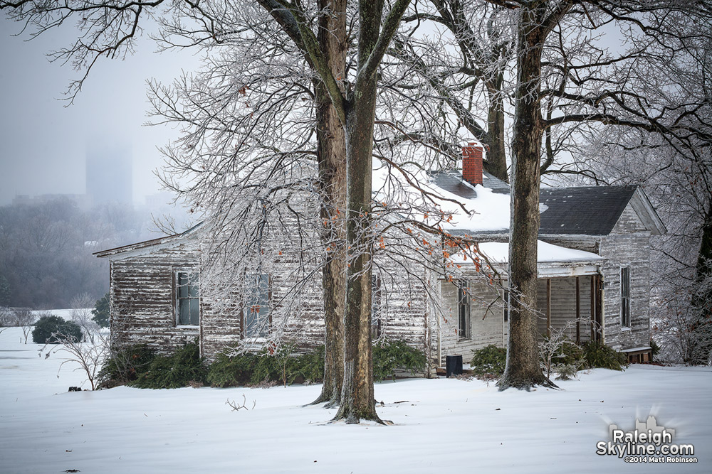 Old House on Dorothea Dix campus in the snow and ice
