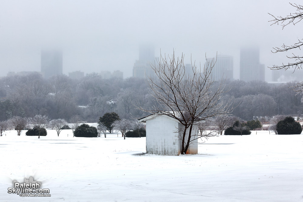 Downtown Raleigh fades into the sky with snow and ice
