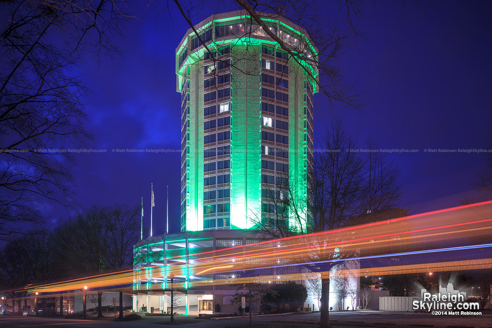 Green lighting on the renovated circular Holiday Inn in Raleigh
