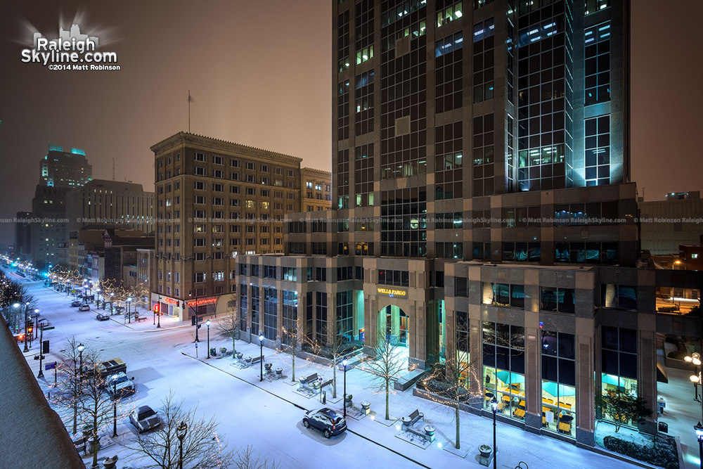 Downtown Raleigh's Fayetteville Street blanketed in snowfall at night