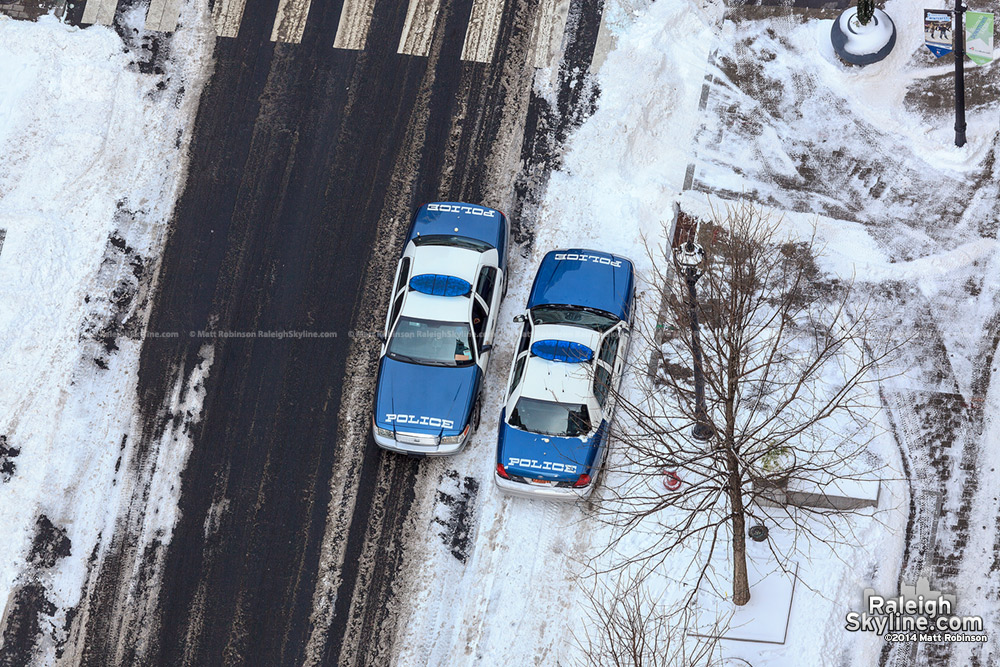 Aerial of Raleigh Police side by side on Fayetteville Street in the snow