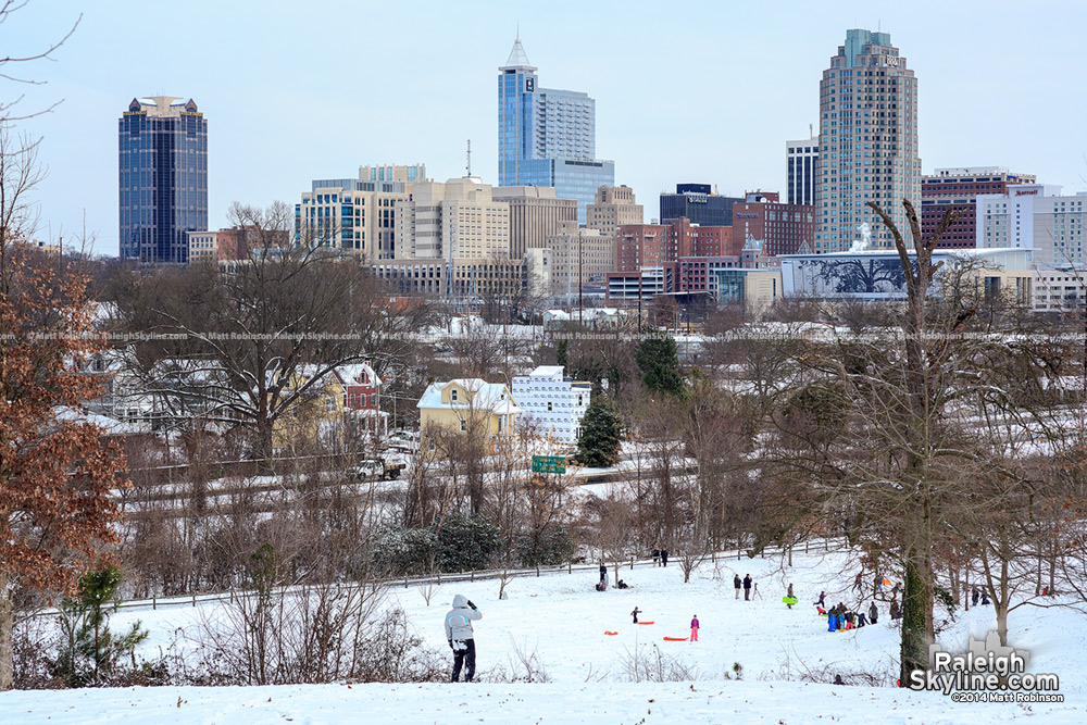 Sledders and Downtown Raleigh Skyline from Dorothea Dix
