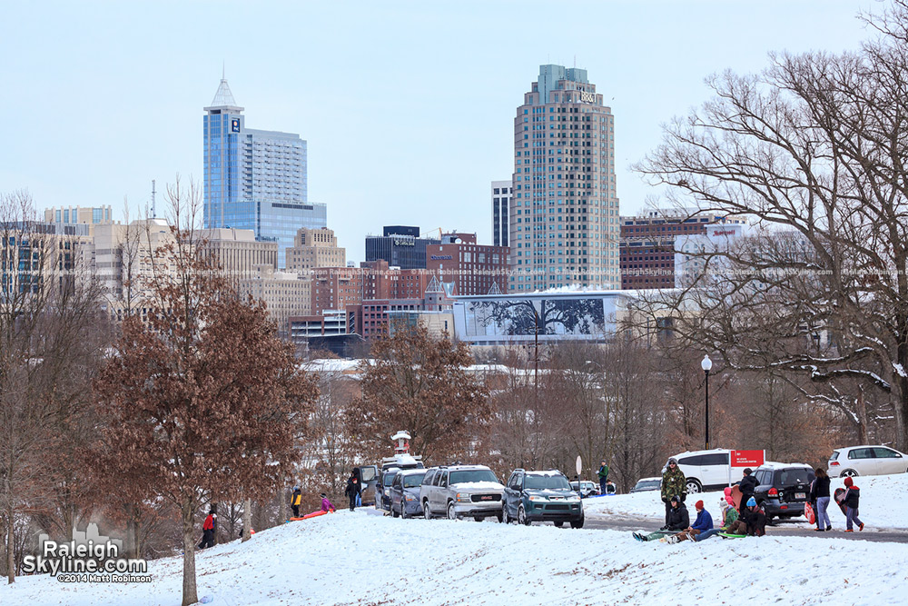 Downtown Raleigh on a snow day with sled riders