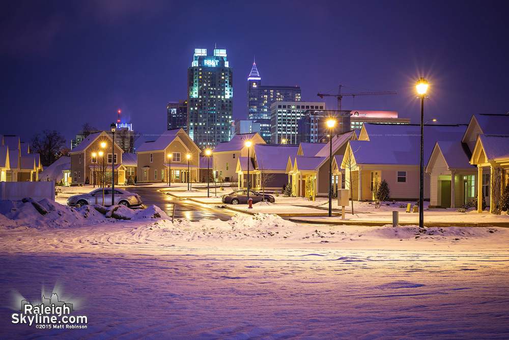 New homes at Walnut Terrace in the Snow with downtown Raleigh