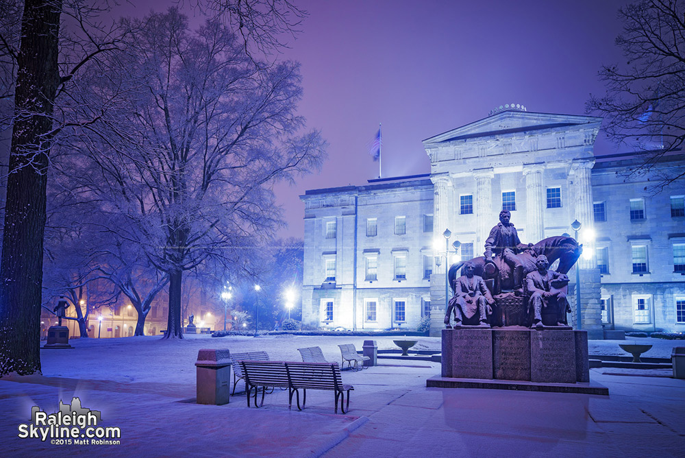 Midnight snow covering the NC State Capitol Building grounds