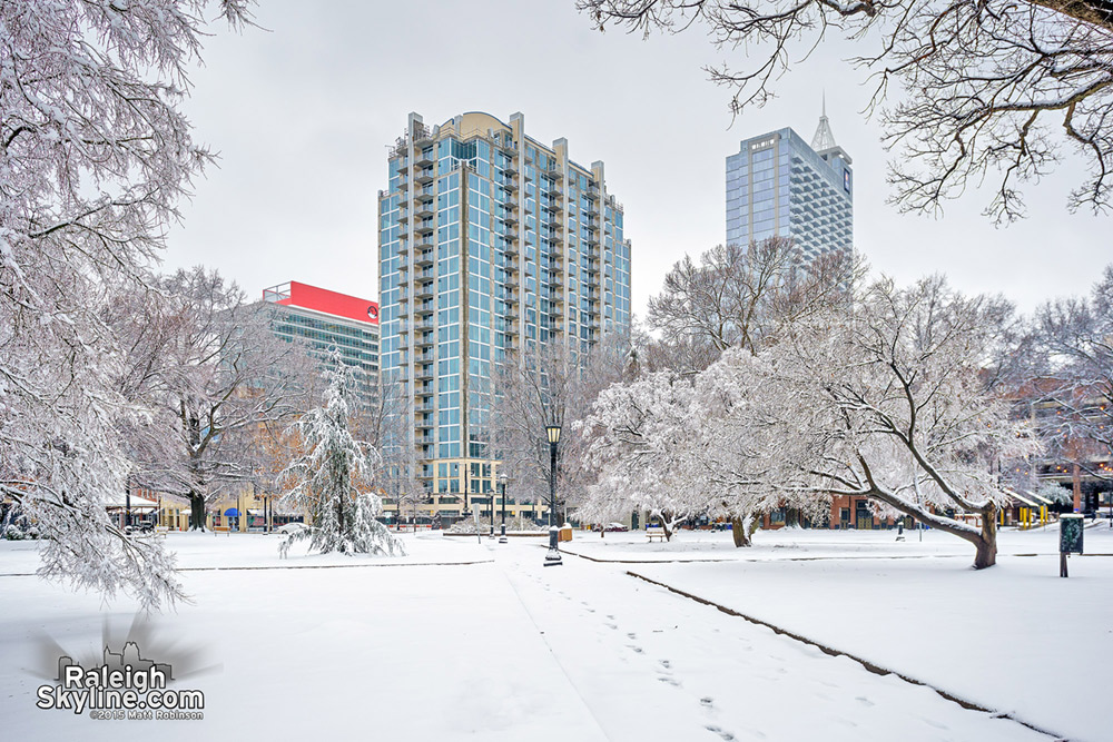 Moore Square winter wonderland with Skyhouse Condominiums and PNC Plaza