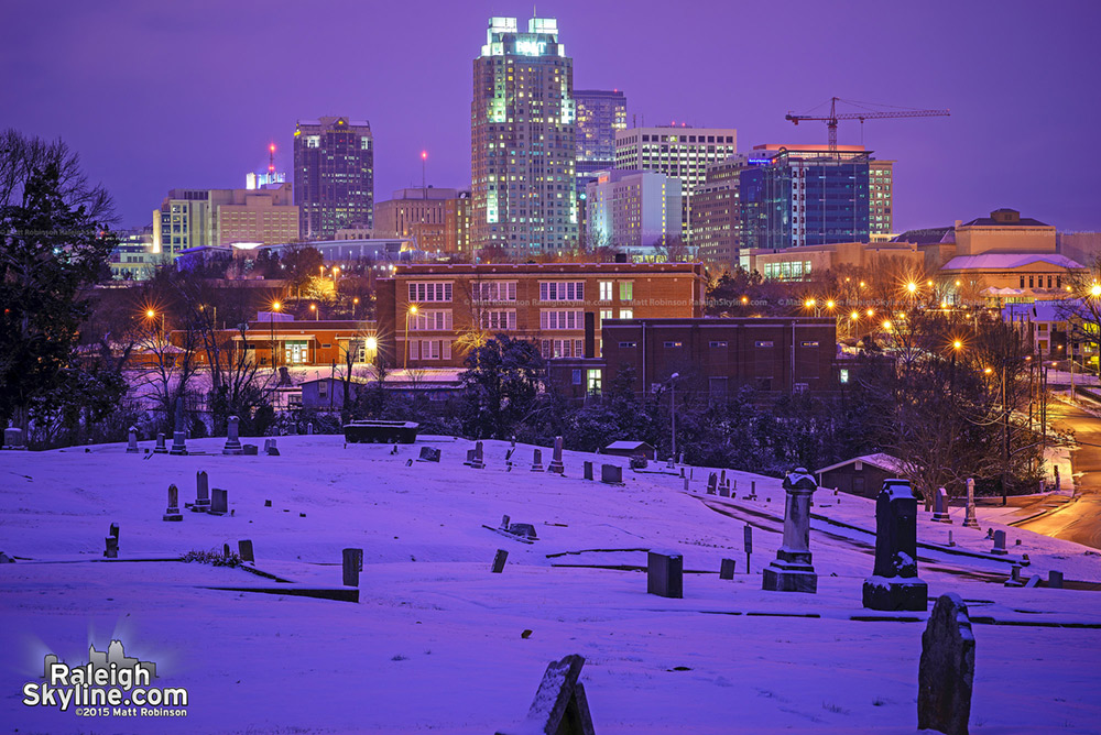 Mount Hope Snow cover at night with Raleigh skyline