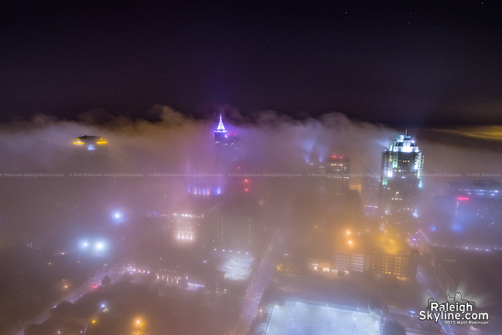 Raleigh buildings rise above fog at night