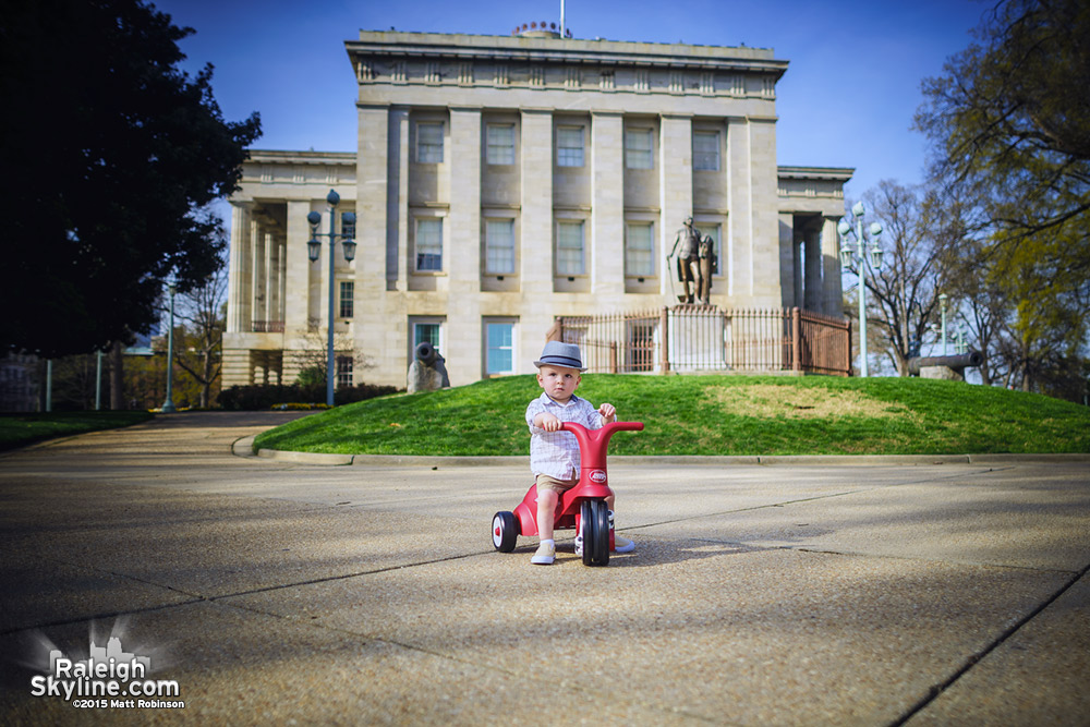 Oliver rides around the State Capitol
