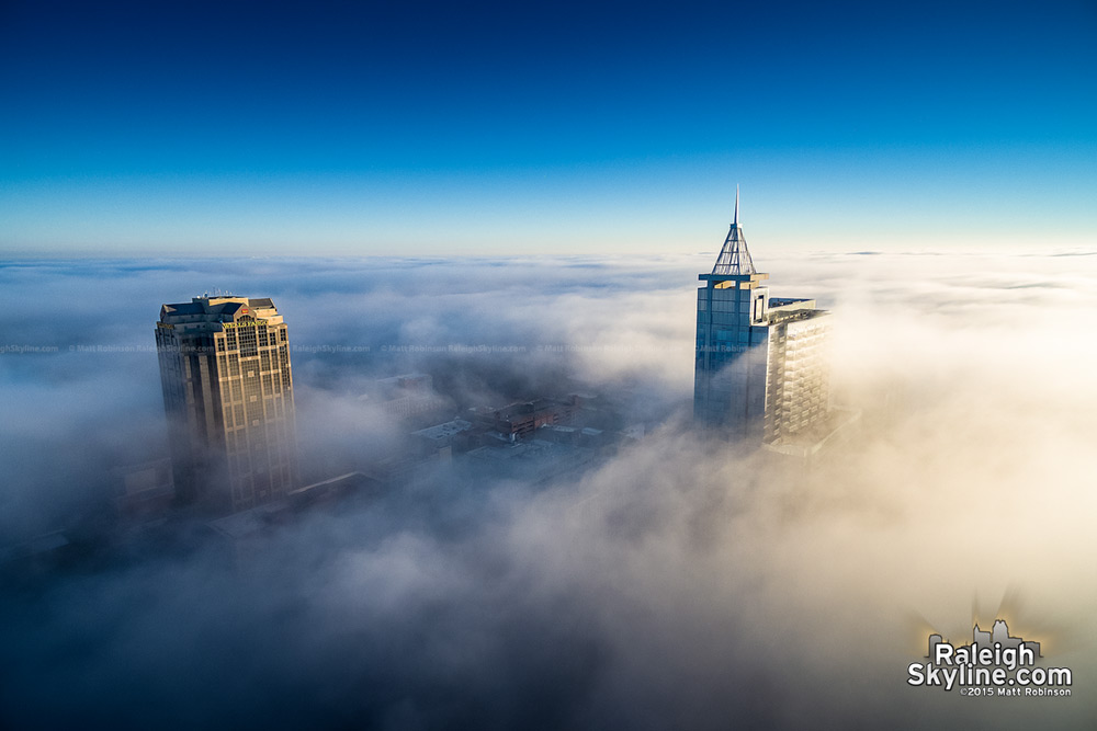 PNC Plaza and Wells Fargo Capitol Center above the fog
