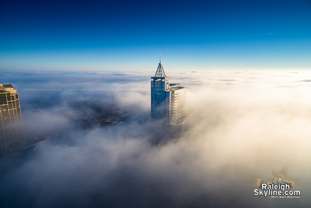 PNC Plaza in downtown Raleigh in the clouds