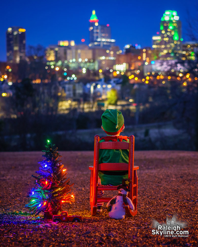 Little elf in the city looking at downtown Raleigh