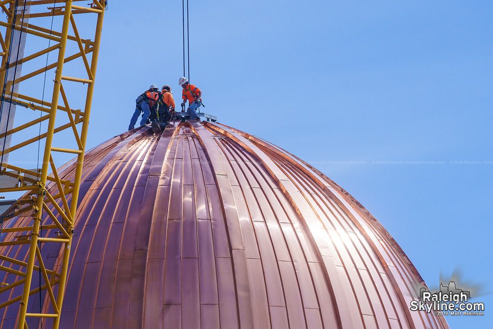 Workers atop the newest dome in Raleigh
