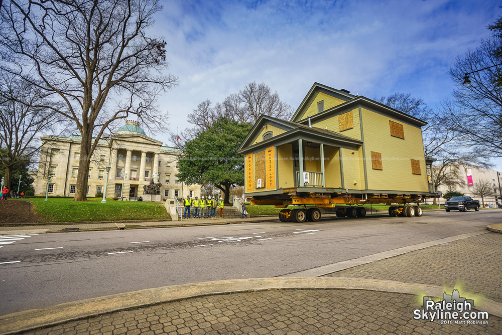 A house rolls past the NC State Capitol