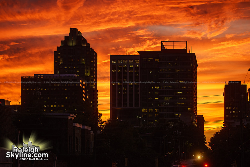 Orange skies behind the Raleigh Skyline