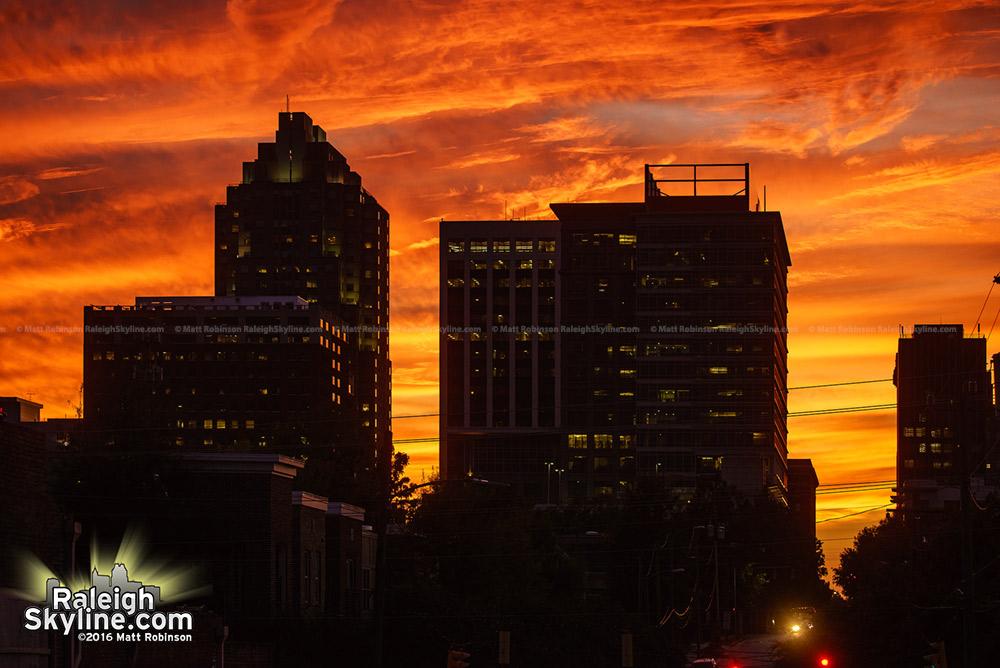 Orange skies behind the Raleigh Skyline