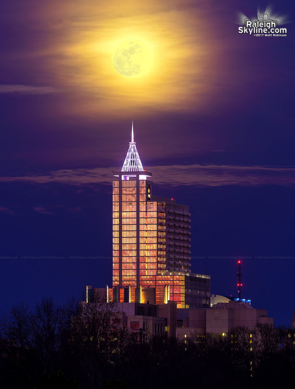 Full moon over PNC Plaza at sunset