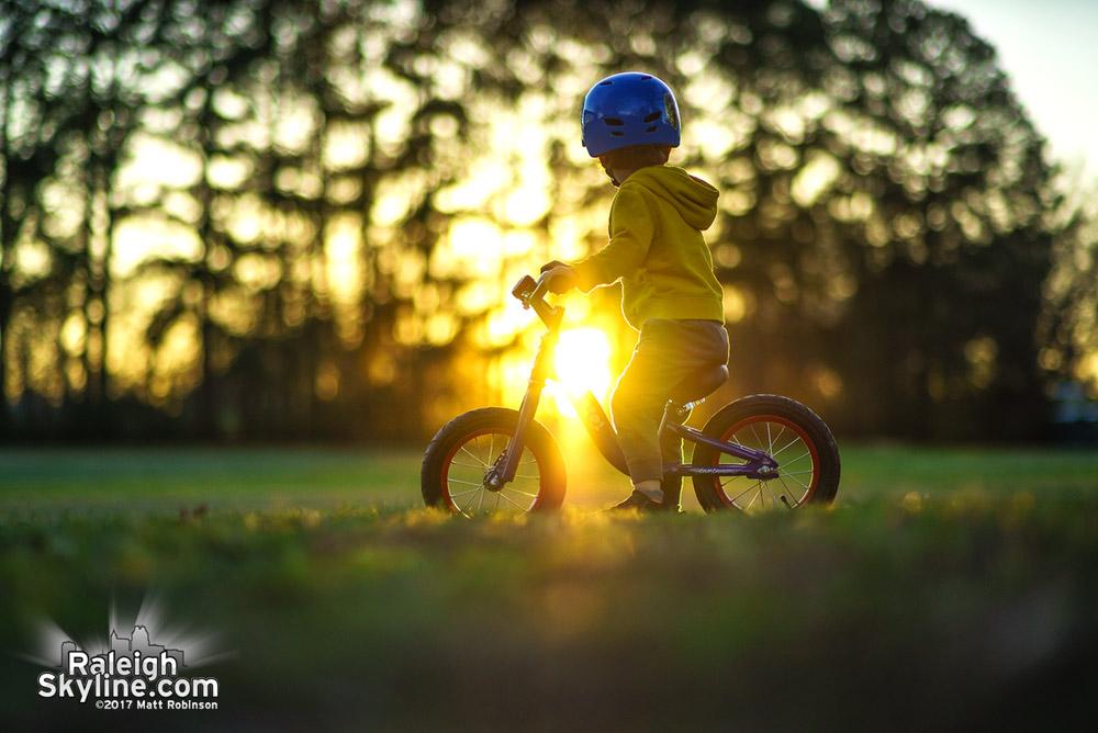 Bike rides through Dorothea Dix at sundown