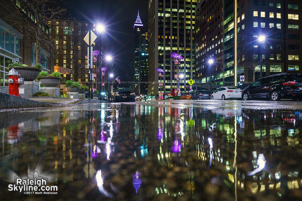Puddles reflect Fayetteville Street