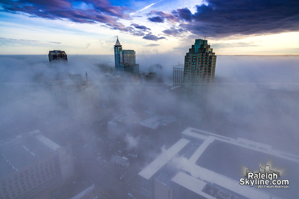 Raleigh rises above the winter fog