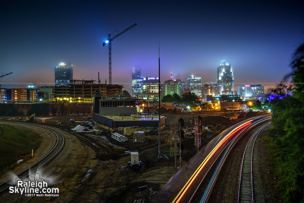 Downtown Raleigh fades into the mist as the Amtrak Piedmont pulls into the station as seen from the Boylan Avenue Bridge