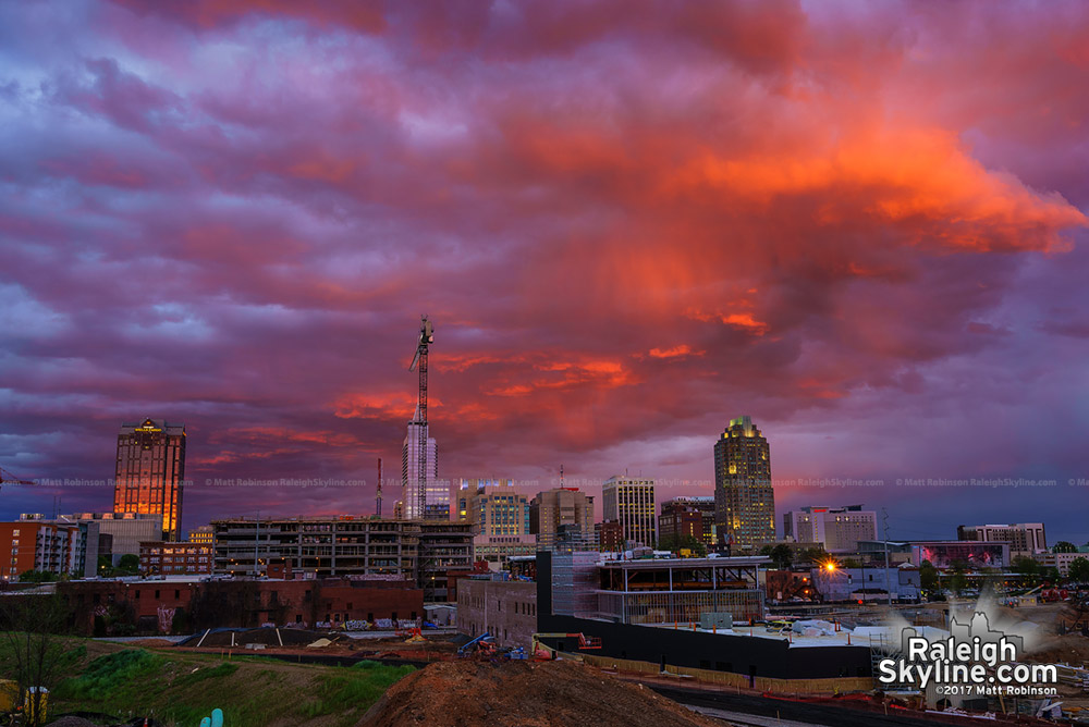 Bright orange clouds over downtown at sunset